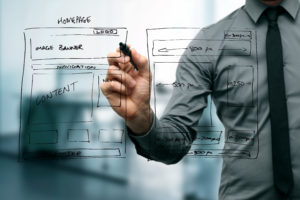 designer drawing website development wireframe in the office